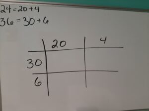 Setting up the box method by separating the numbers into place value